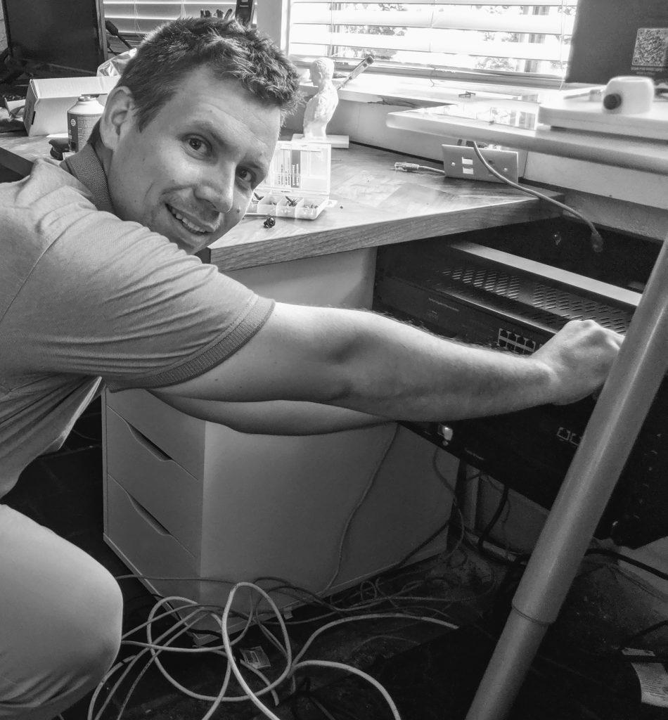 Hans Arndt installing a server rack